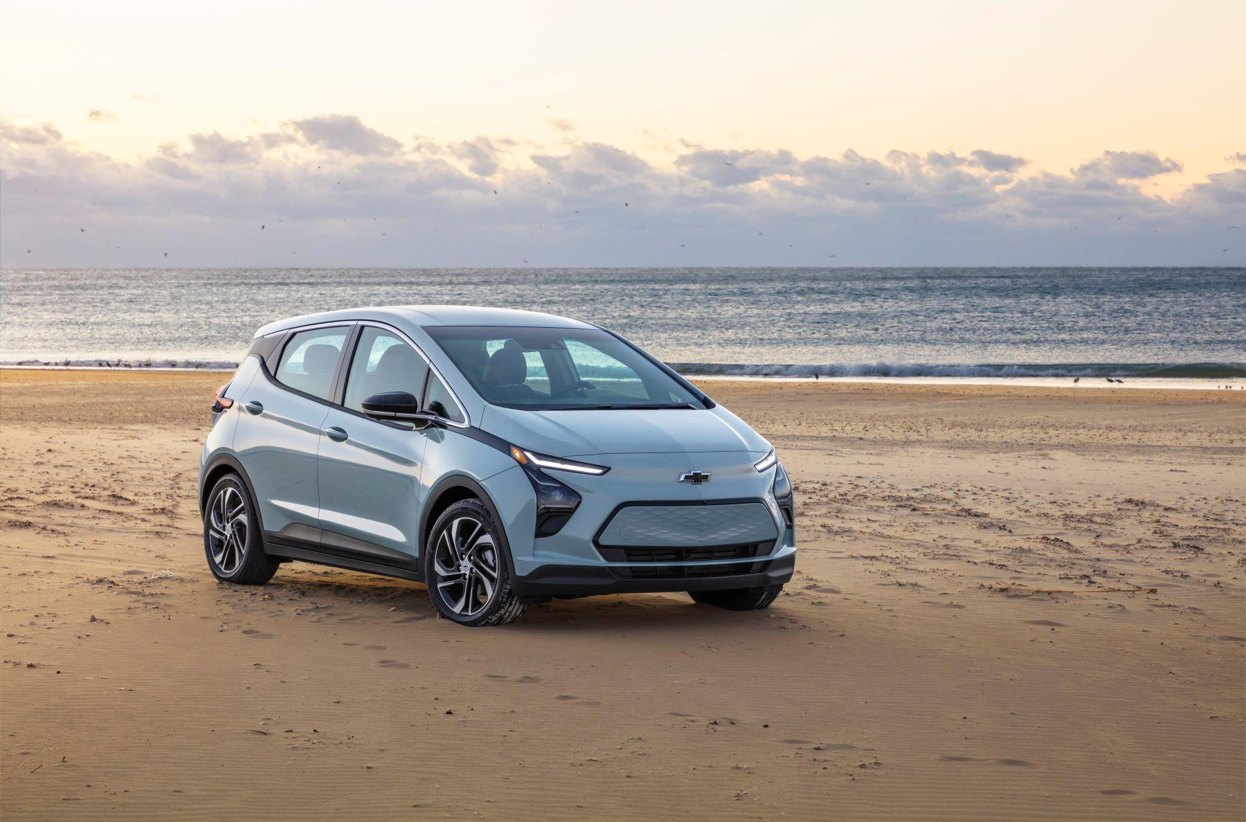 A gray 2022 Chevy Bolt EV model parked on a beach