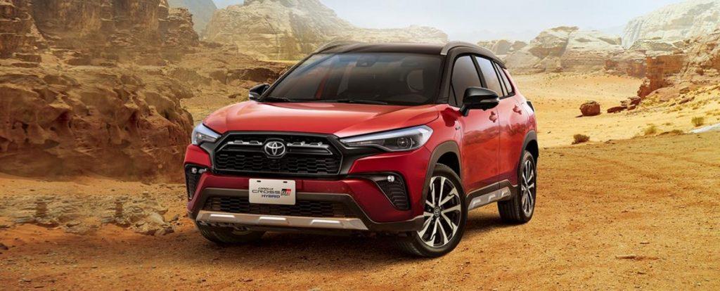A red Toyota Corolla Cross Gr Sport drives through the desert