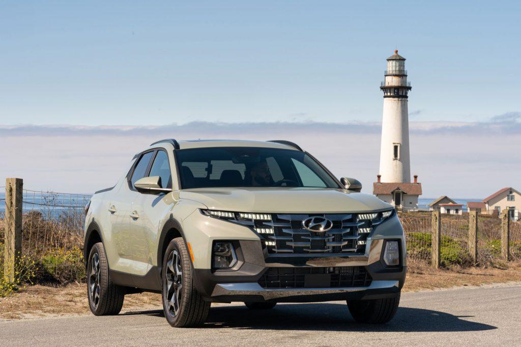 2022 Hyundai Santa Cruz sport adventure vehicle parked near a lighthouse