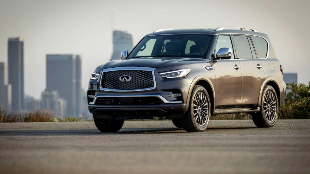 A brown 2022 Infiniti QX80 parked within view of a city skyline.