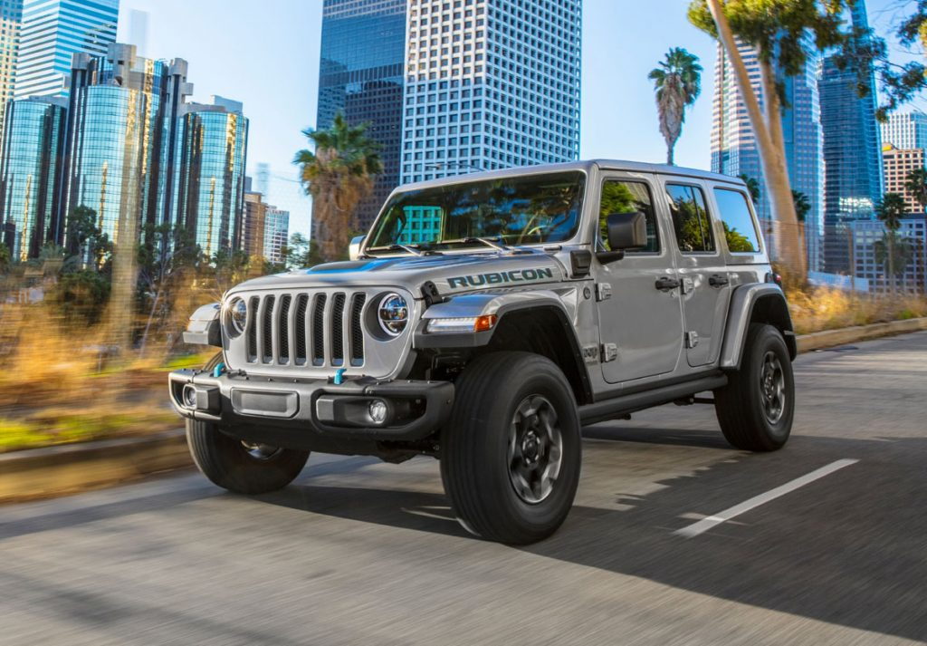 The 2021 Jeep® Wrangler Rubicon 4xe driving in the city