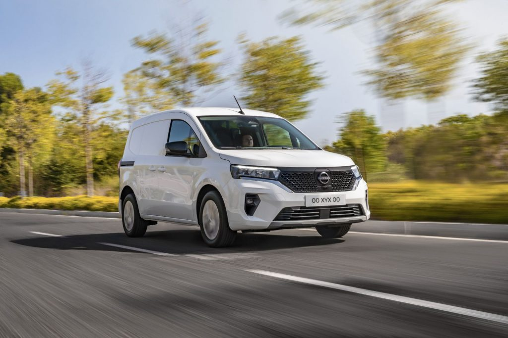 a white 2022 Nissan Townstar EV driving on a road during the day