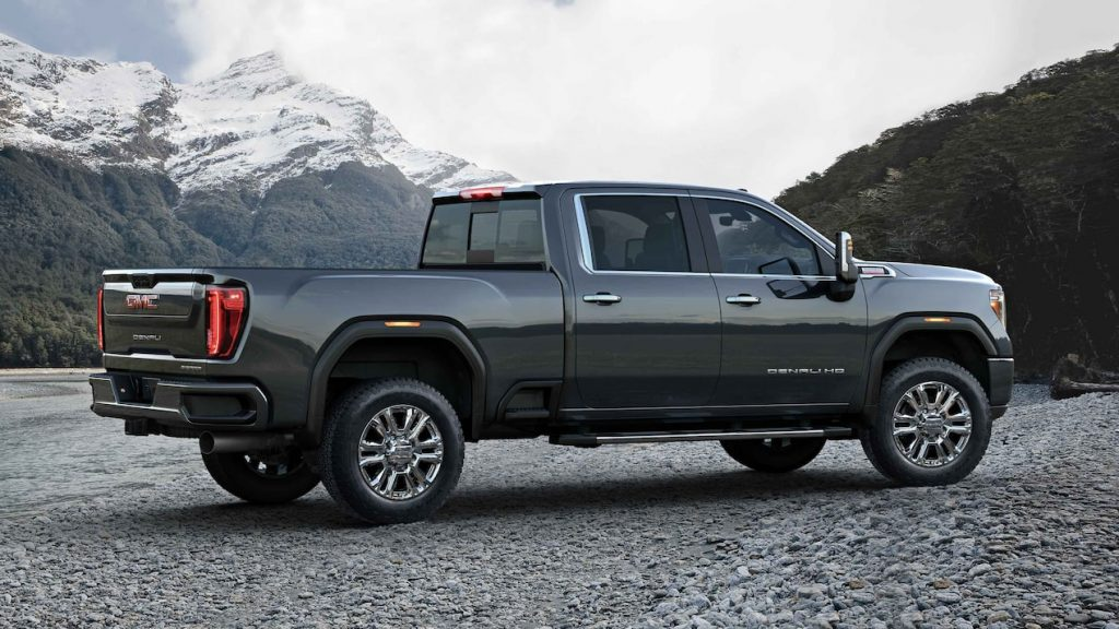 A gray 2022 GMC Sierra HD Denali parked with a mountainous background