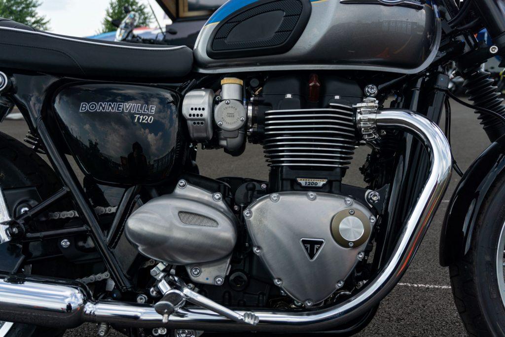 A close-up view of a blue-and-silver 2022 Triumph Bonneville T120's engine