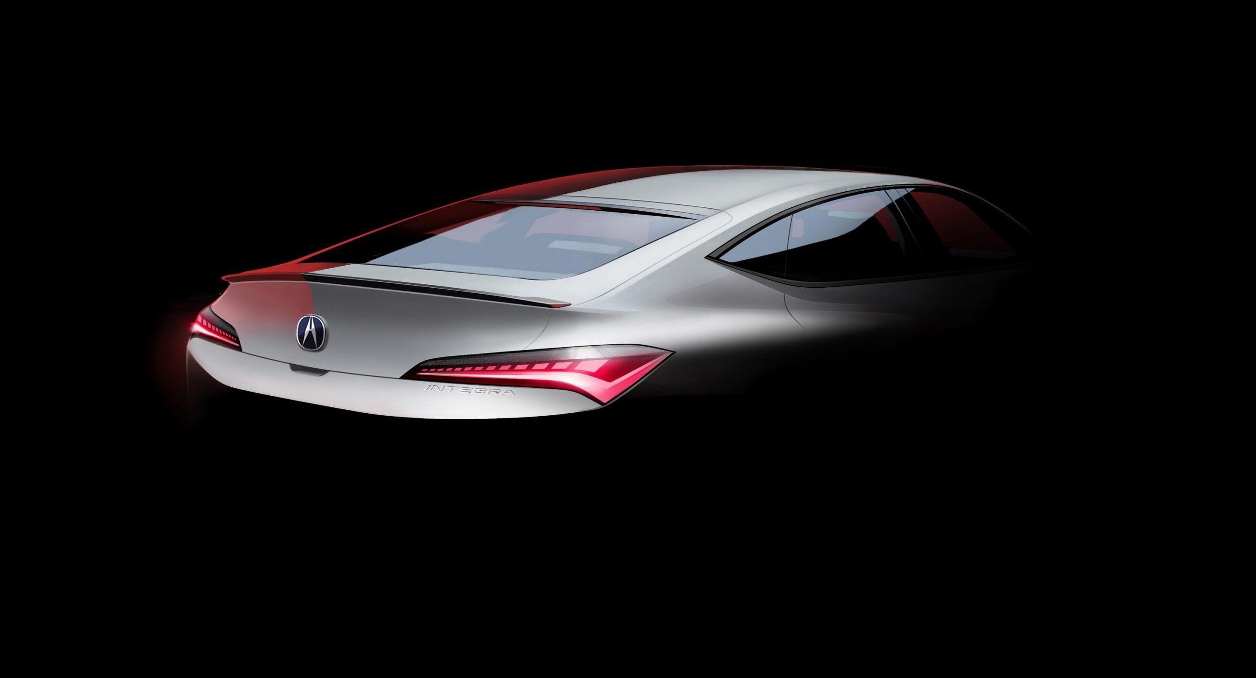 The rear 3/4 of a white 2022 Acura Integra