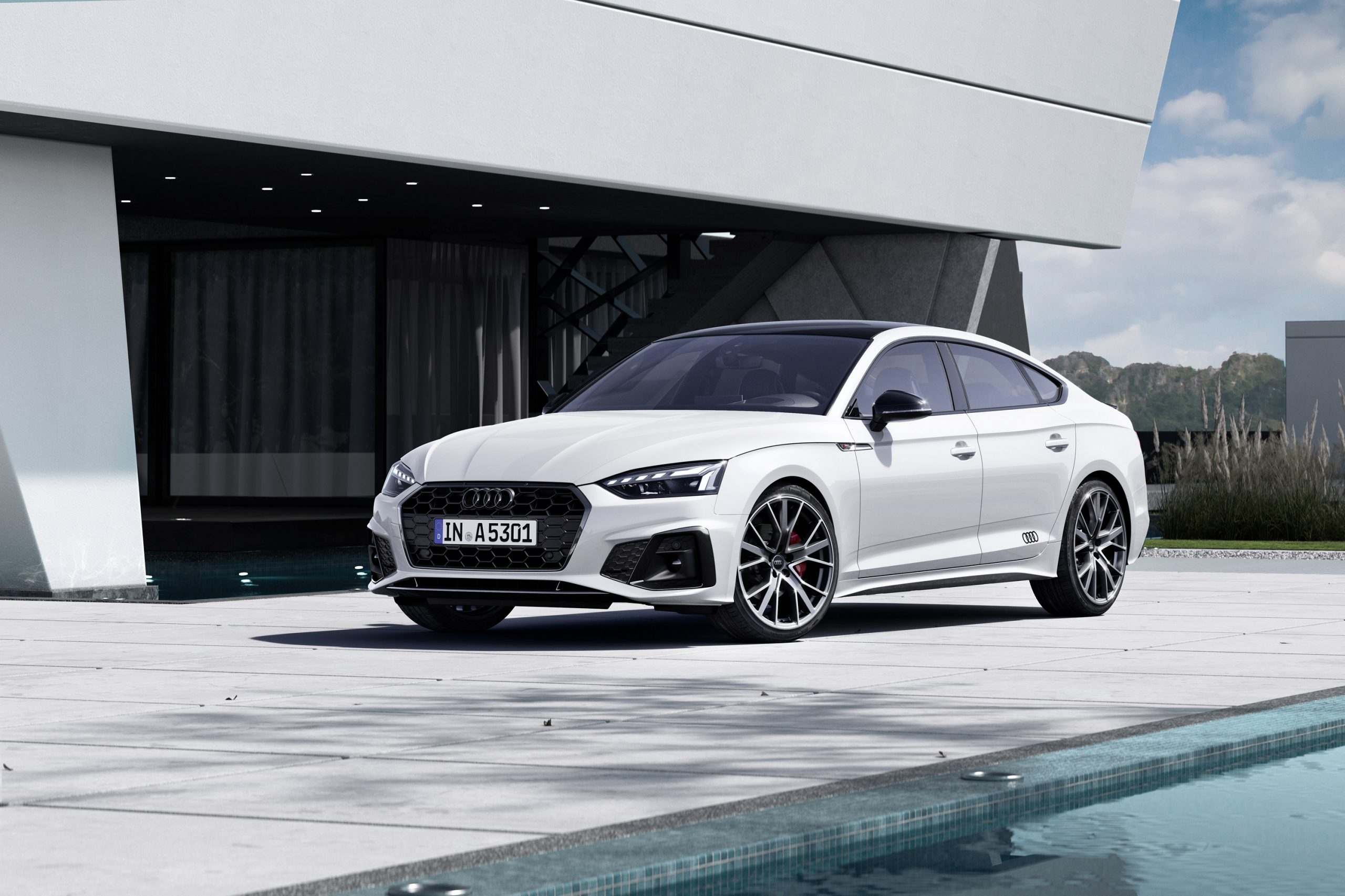 A white 2022 Audi A5 sportback luxury car shot from the front 3/4 detail