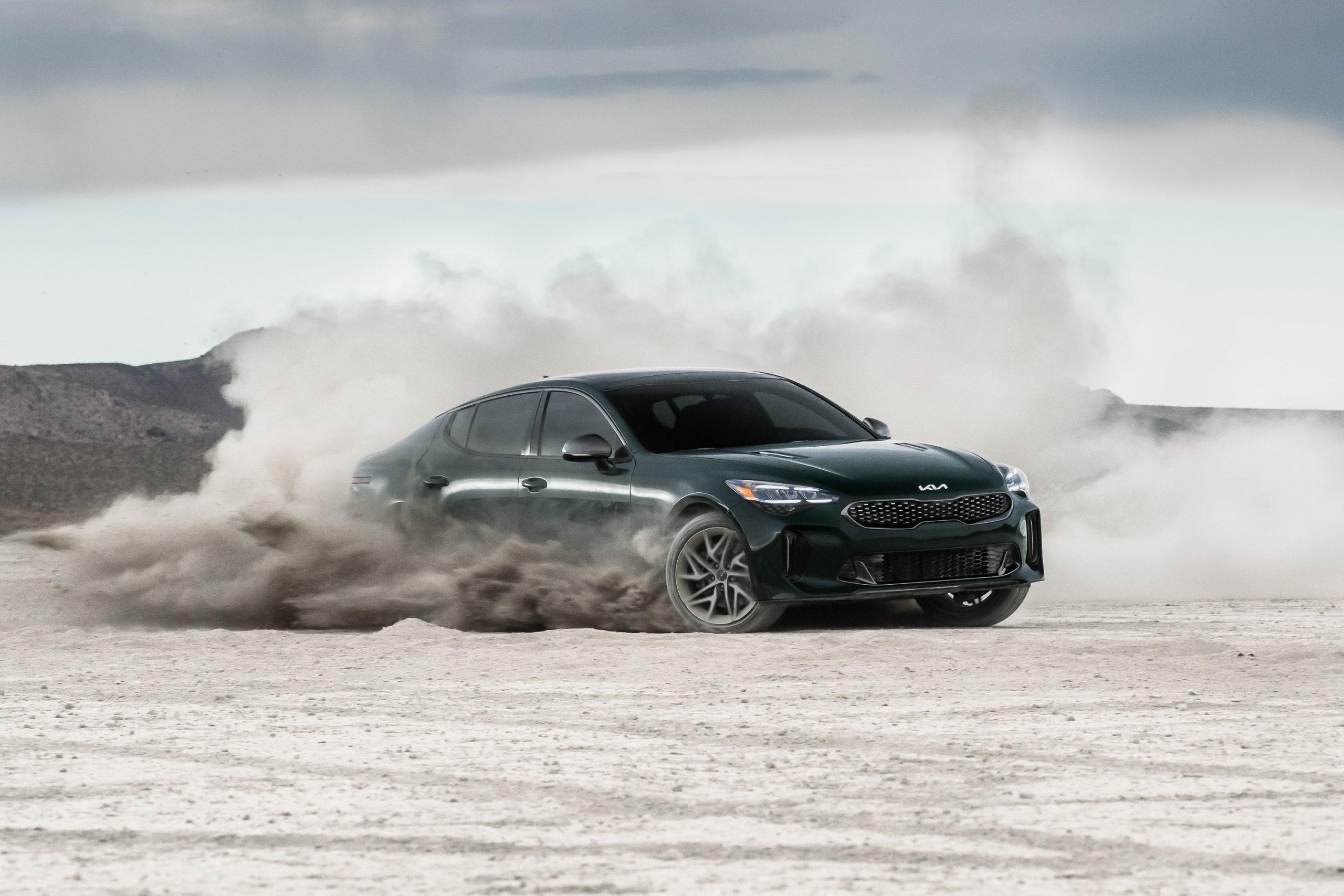 A black Stinger GT-Line gets sideways in the sand