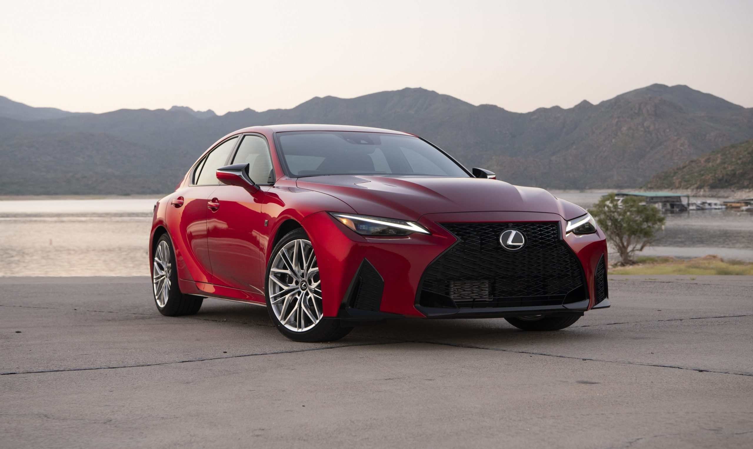 The 2022 Lexus IS 500 luxury car in red, shot from the front 3/4 angle