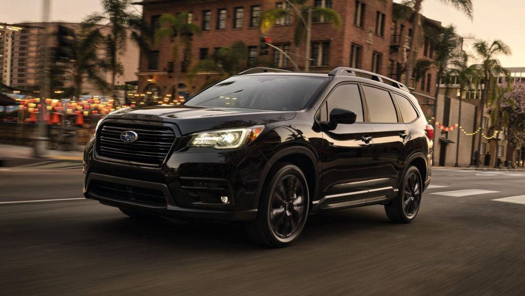 The 2022 Subaru Ascent driving in the city
