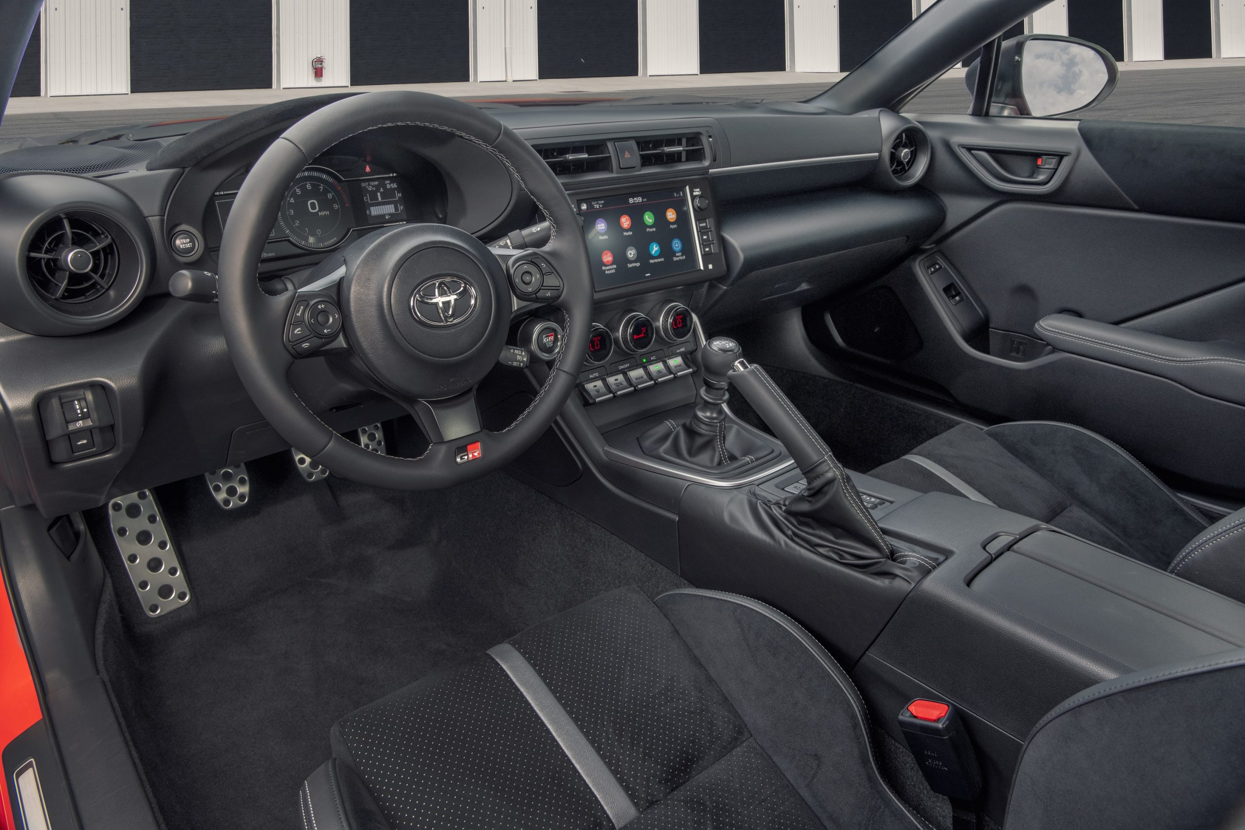 The alcantara clad interior of the Toyota GR 86 Premium shot from the driver's side window