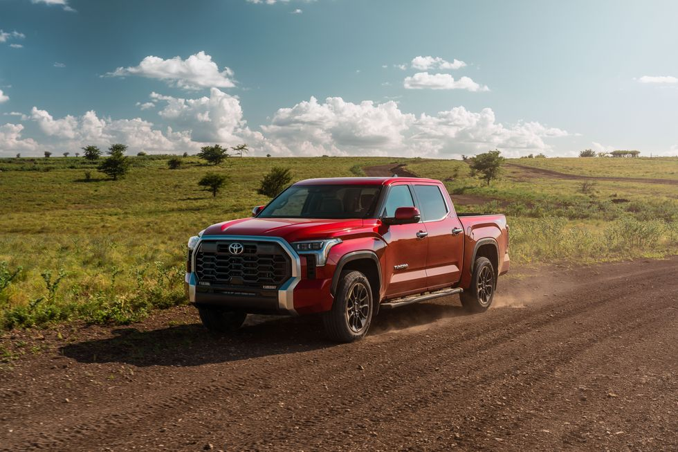 A red 2022 Toyota Tundra on a dirt road.