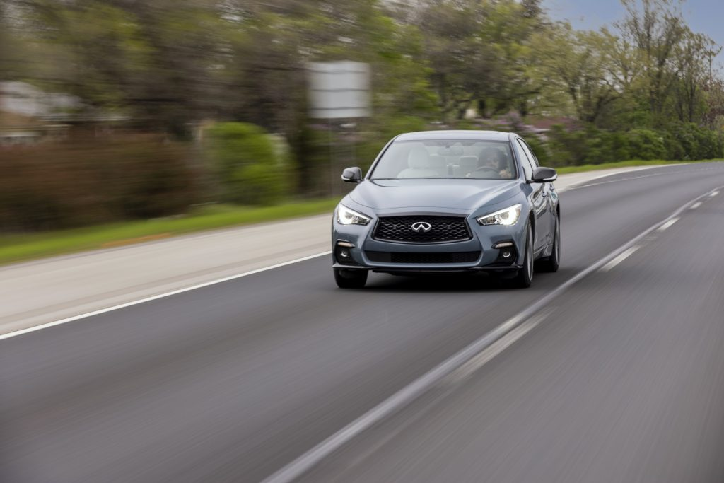 The 2022 Infiniti Q50 driving down the road