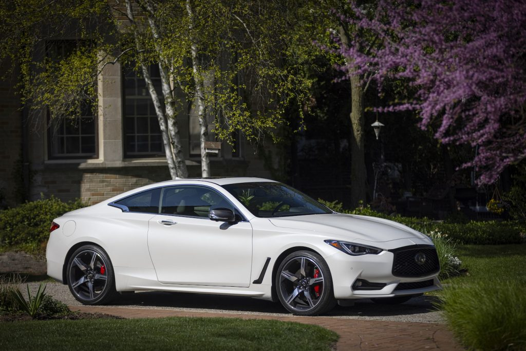 The 2022 Infiniti Q60 parked near a home