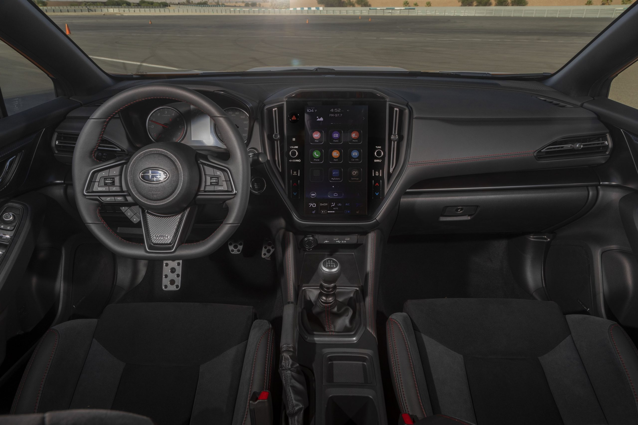 The black interior of the 2022 Subaru WRX with manual transmission, shot from the center rear seat