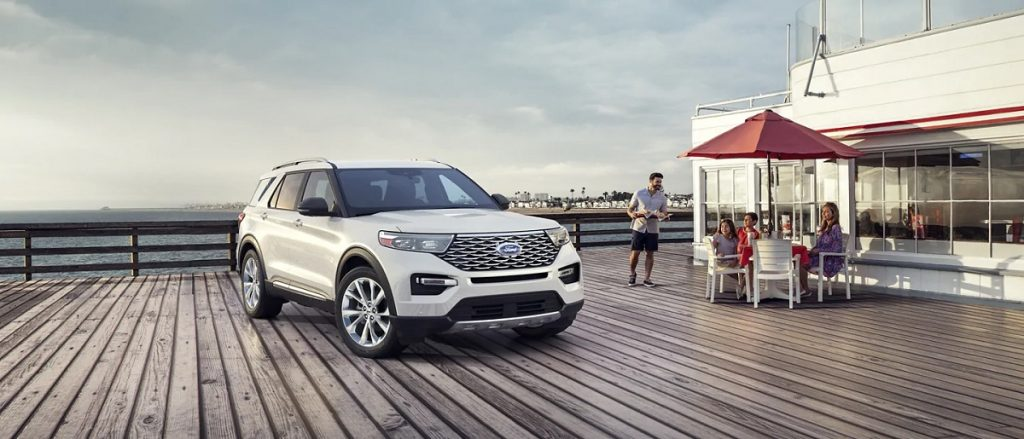 A white 2021 Ford Explorer parked on a boardwalk.