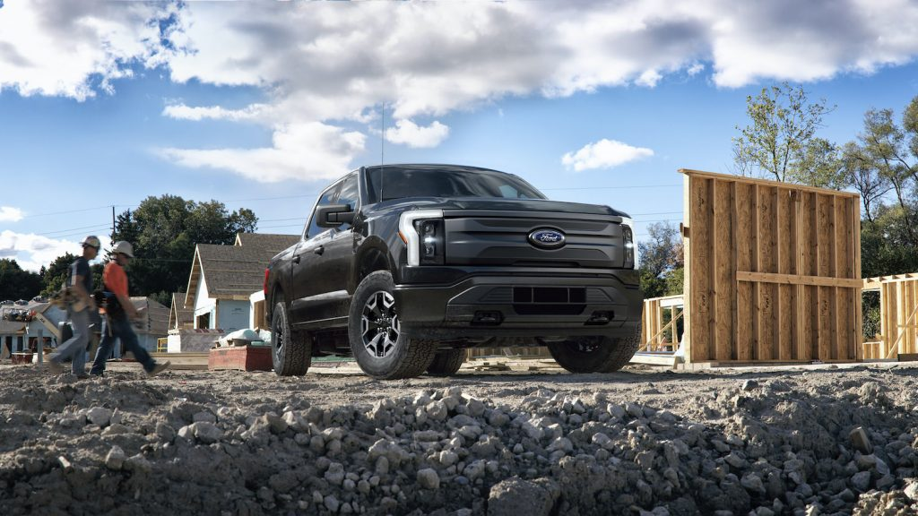 Publicity shot of a black 2022 Ford F-150 Lightning Pro. Pre-production model with available features shown. Available starting spring 2022.