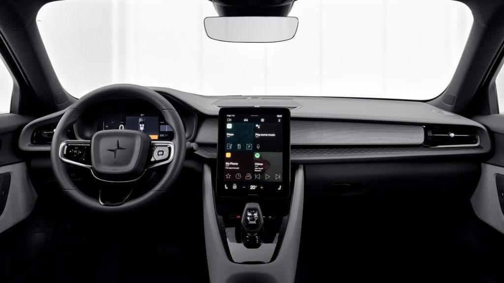 The minimalist black interior on the Polestar 2