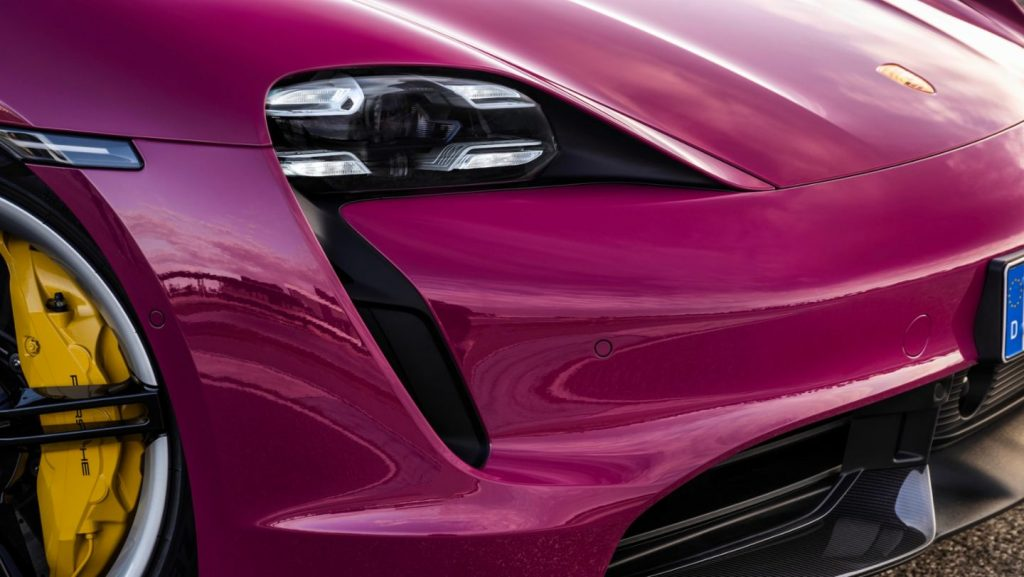 The front of a hot pink 2022 Porsche Taycan.