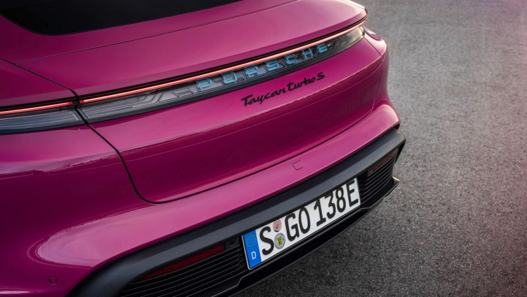 The back of a hot pink 2022 Porsche Taycan.