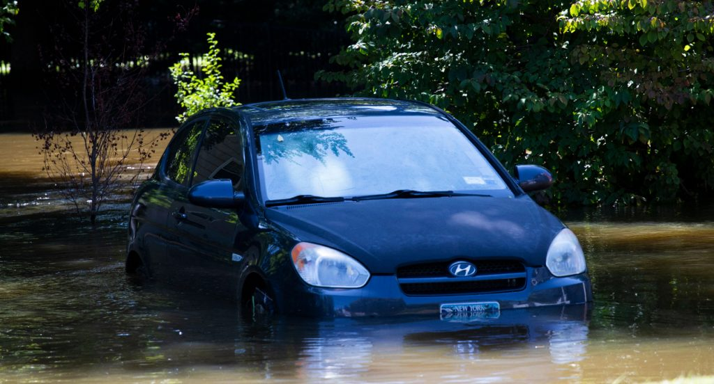 A car sits in a flooded parking spot after a night of high winds and rain from the remnants of Hurricane Ida.