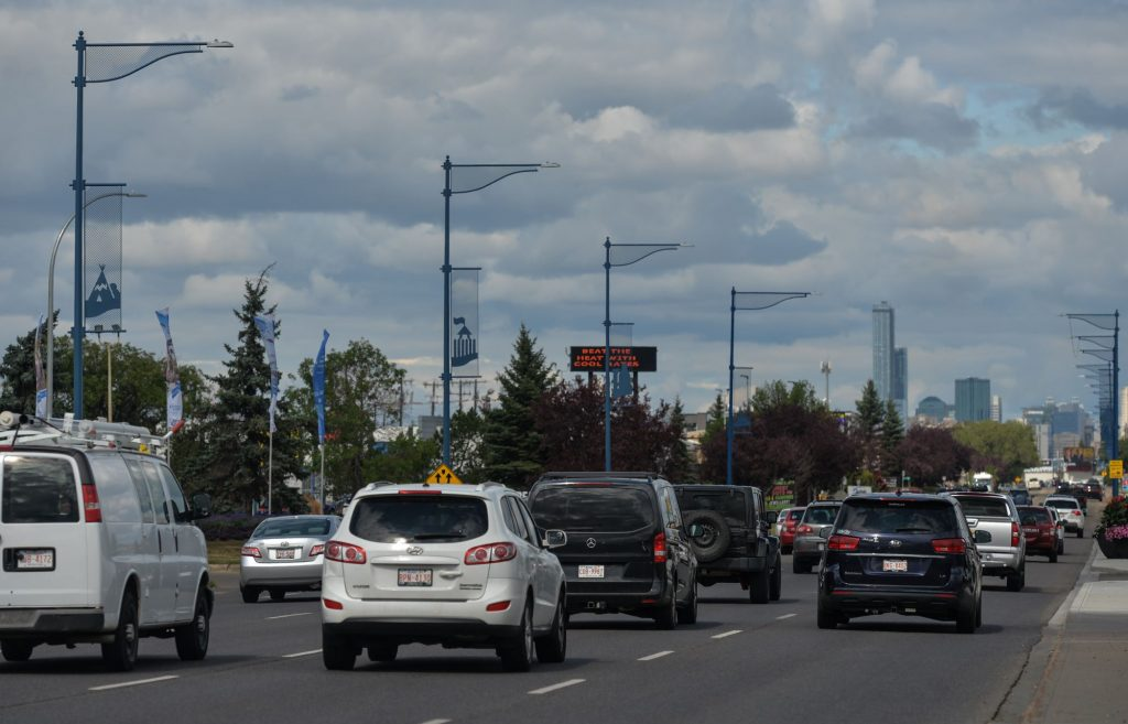 A busy highway with numerous vehicles where car safety is important.