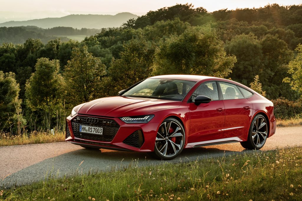 A red 2021 Audi RS7 shot from the high front 3/4 angle on a mountain road