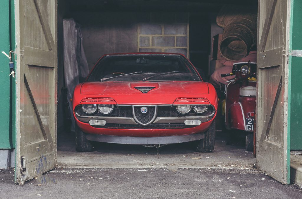 Alfa Romeo barn find poking its nose out of the garage doors