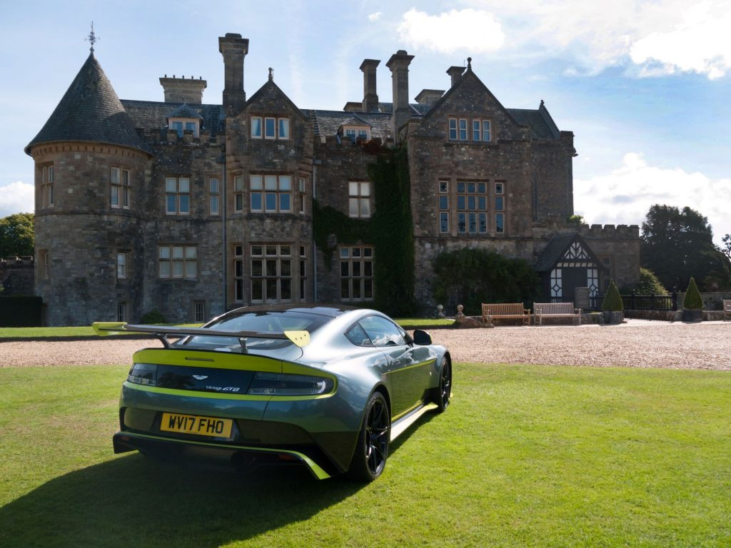 The 2017 Aston Martin Vantage GT8 parked in front of a mansion