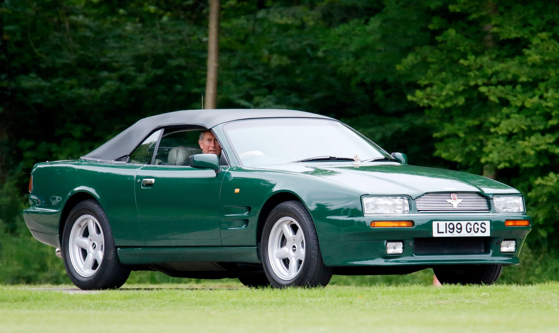 An Aston Martin Virage Volante model being driven by Prince Charles