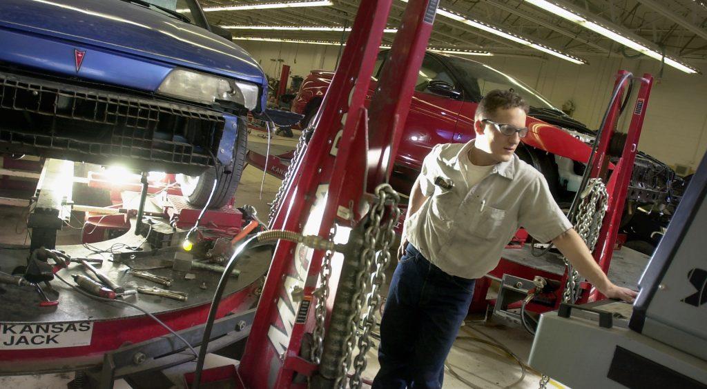 Automotive Technician Working On Car