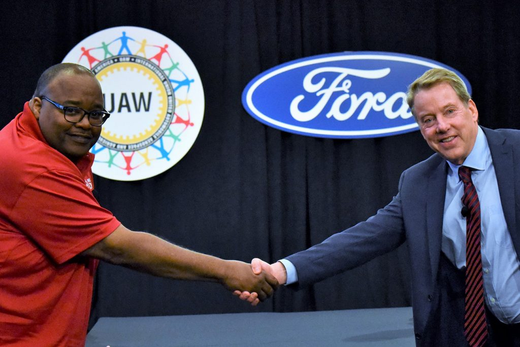 UAW International Vice President Rory Gamble (left) shaking hands with Bill Ford executive chairman of Ford Motor Company (right). Ford is in discussions with the UAW regarding tracking the vaccination of hourly employees