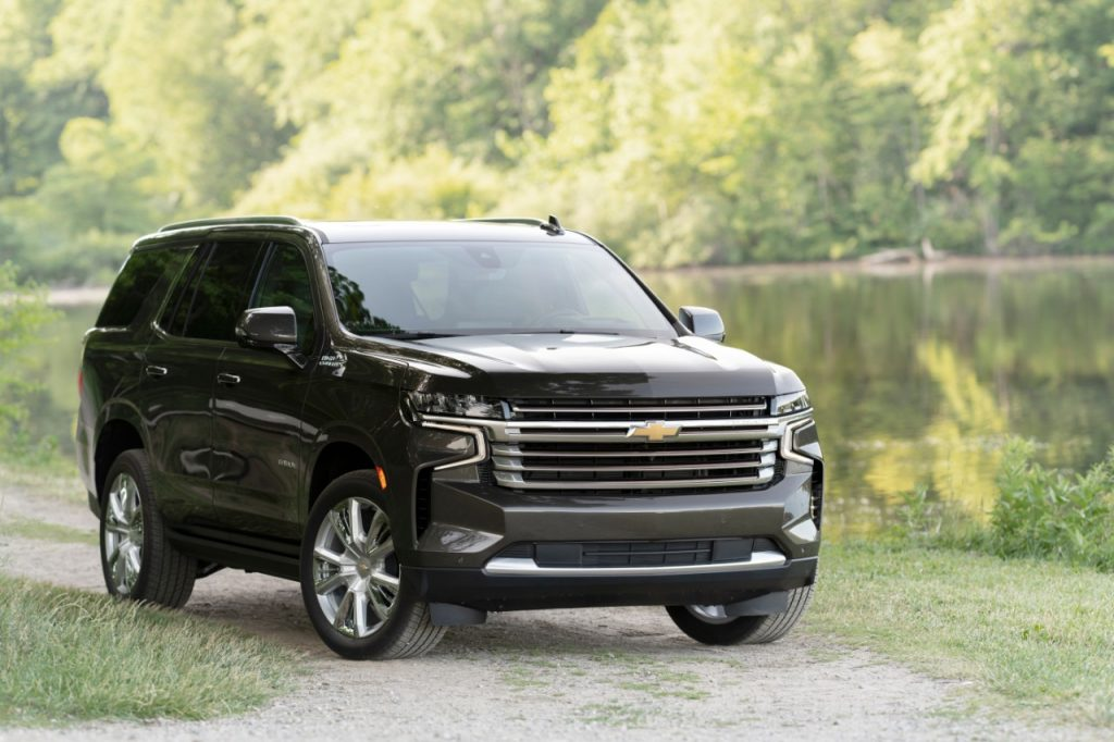 Black 2021 Chevrolet Tahoe parked next to a lake