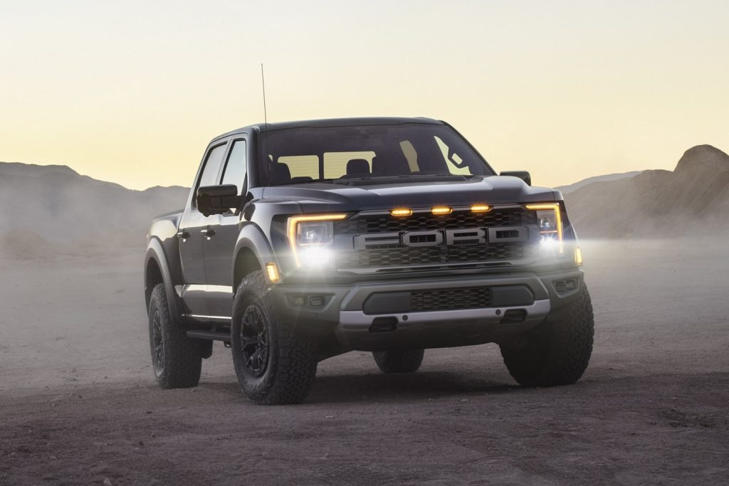 Black 2021 Ford F-150 Raptor with mountains in the background
