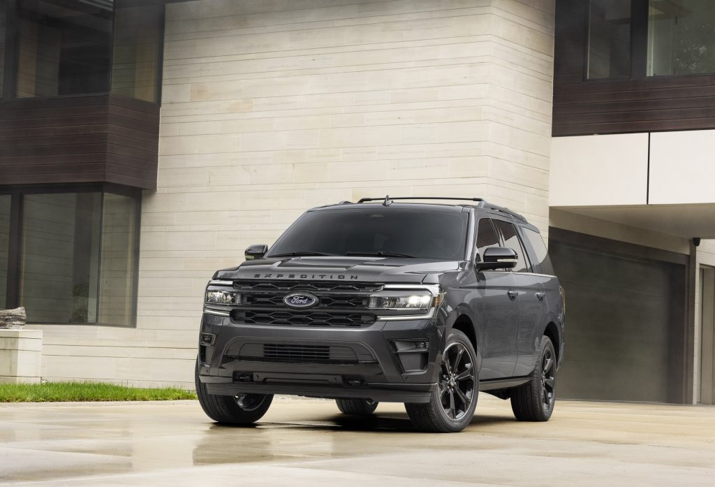 Black 2022 Ford Expedition Stealth Edition Performance Package parked in front of a white building
