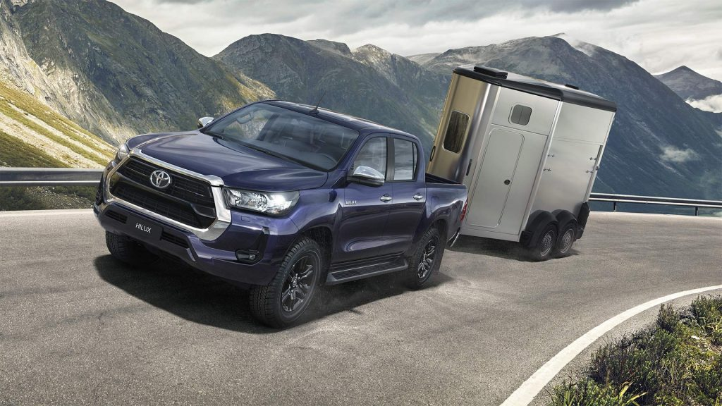 Blue 2021 Toyota Hilux towing a trailer