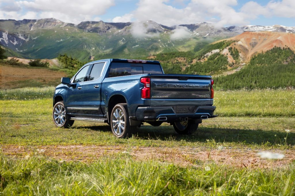 Blue 2022 Chevrolet Silverado with mountains in the background
