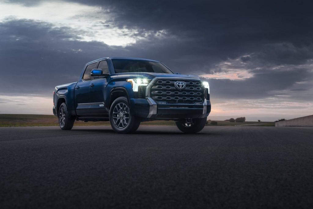 Blue 2022 Toyota Tundra with a cloudy sky in the background
