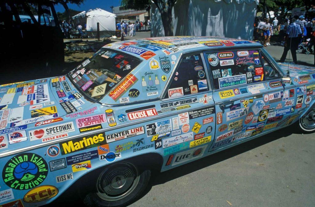 Blue car covered in bumper stickers