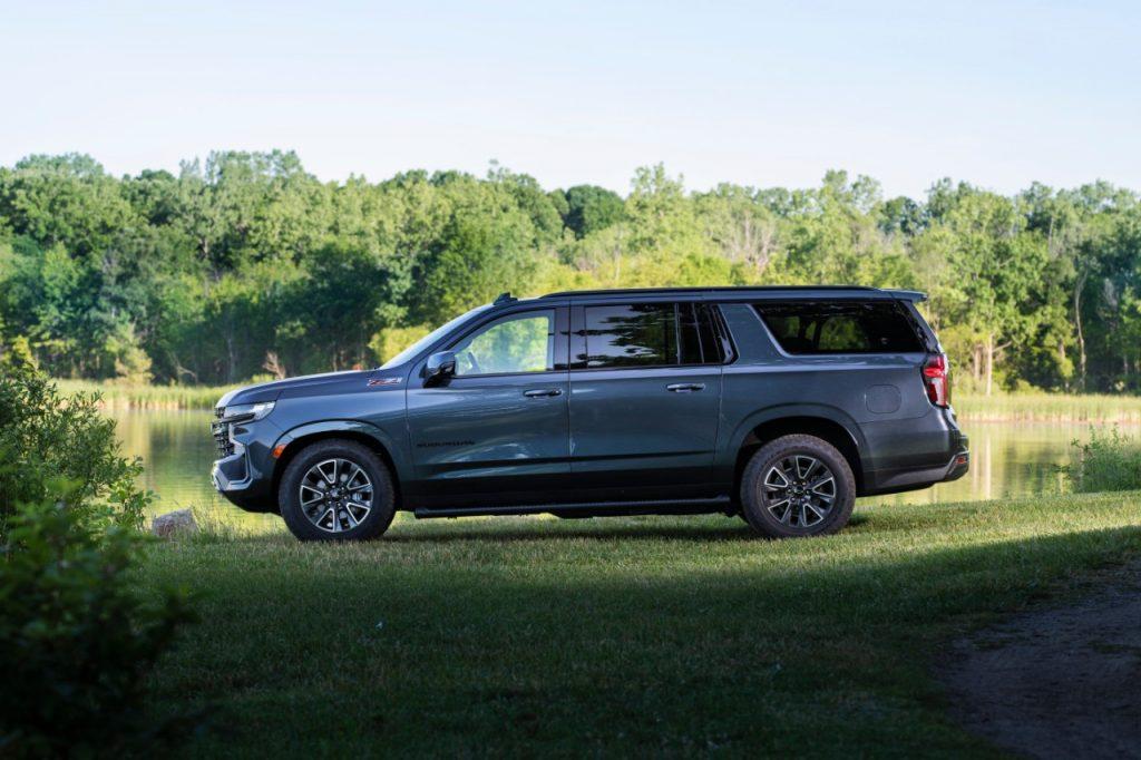 Blue-gray 2021 Chevrolet Suburban parked next to a lake