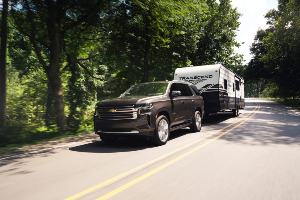 Brown 2021 Chevy Tahoe towing a camping trailer