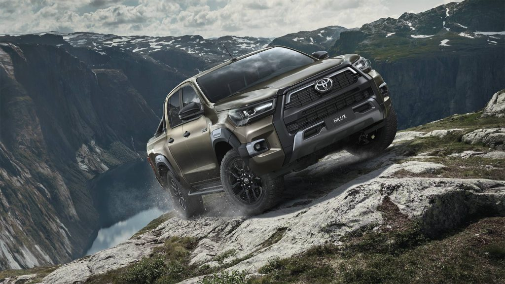 Brown 2021 Toyota Hlux driving on mountainous terrain
