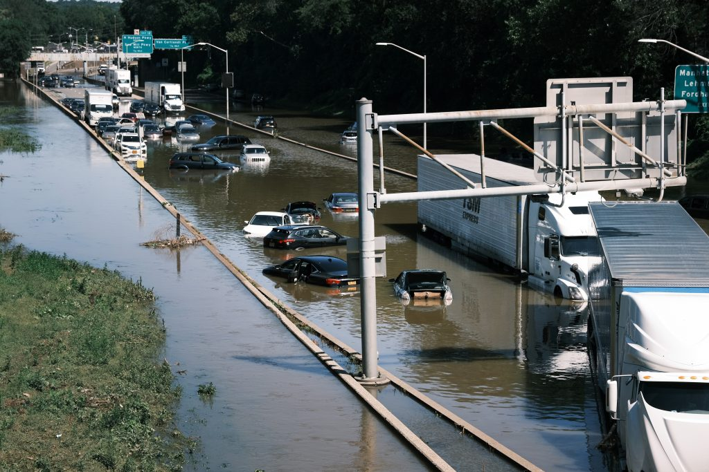 Cars On Flooded Highway