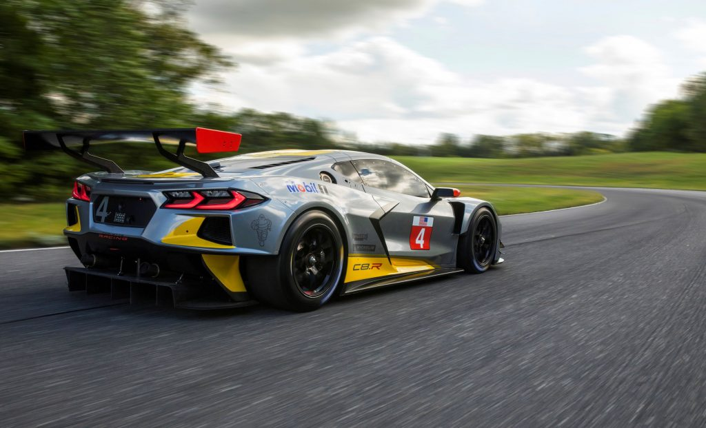 The rear 3/4 view of the gray-and-yellow Chevrolet Corvette C8.R on a racetrack