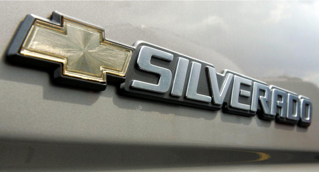 The Chevrolet Silverado logo badge on a truck.