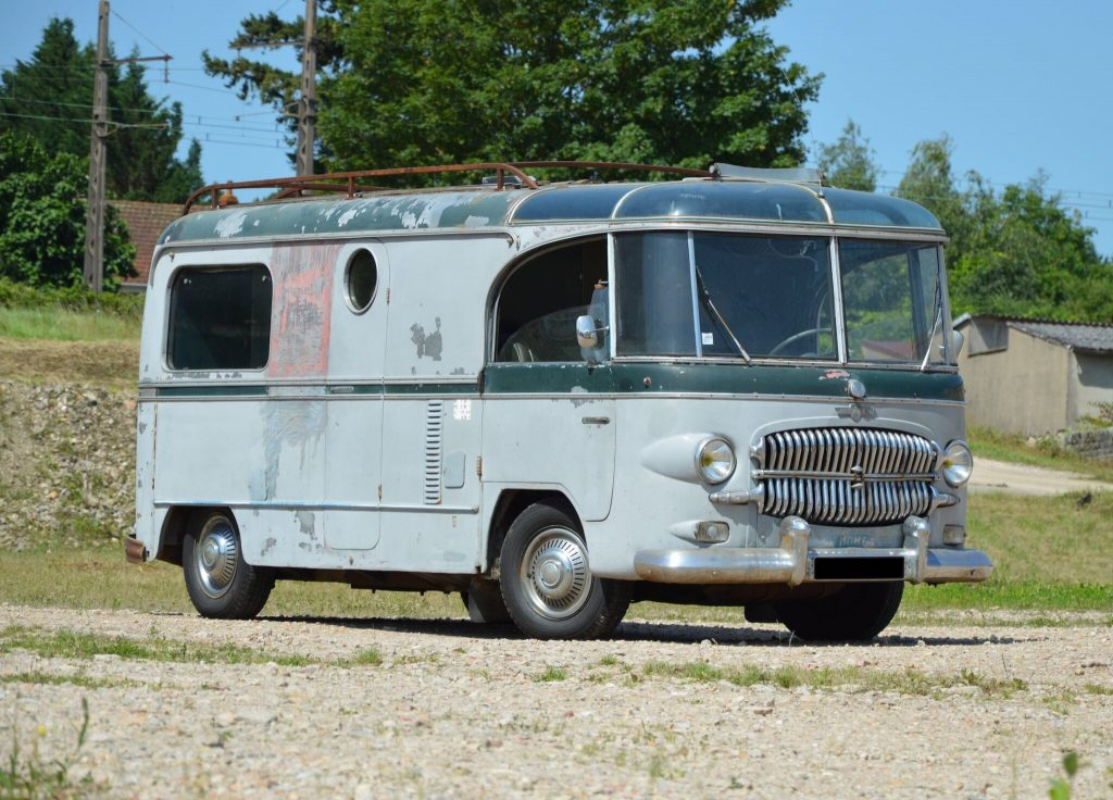 This Custom Citroen H Van is one of the coolest vintage campers we've ever seen. It shows a good bit of wear as it sits parked in a field