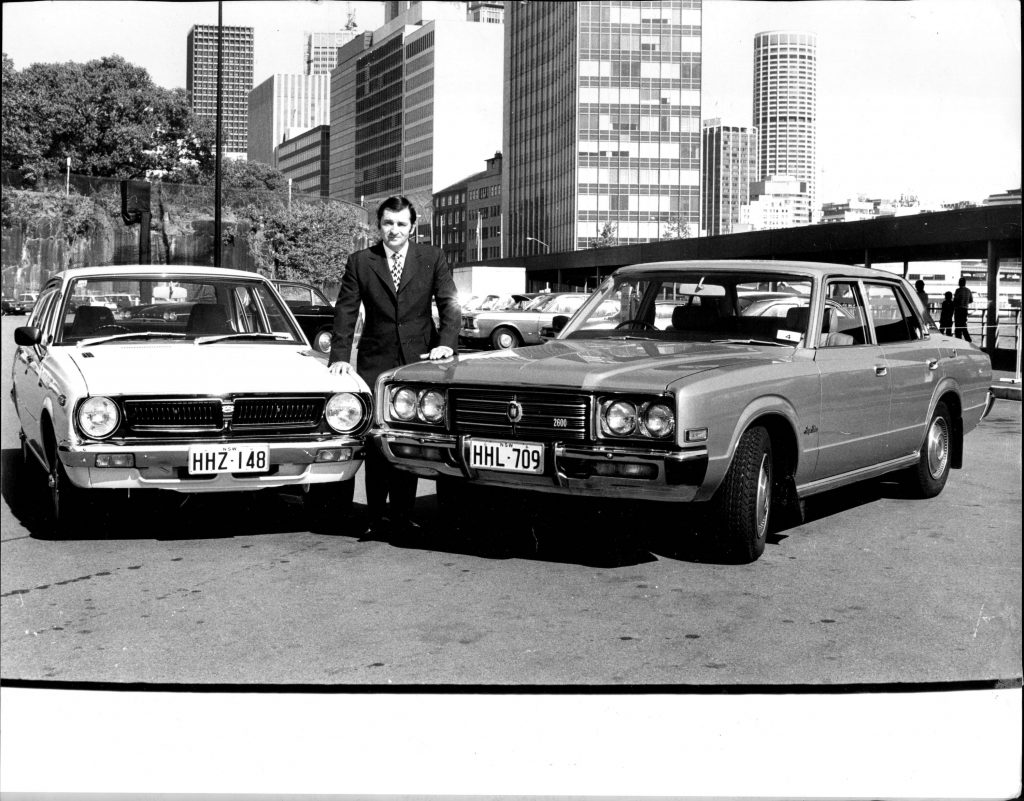 Vintage Toyotas in black and white photo