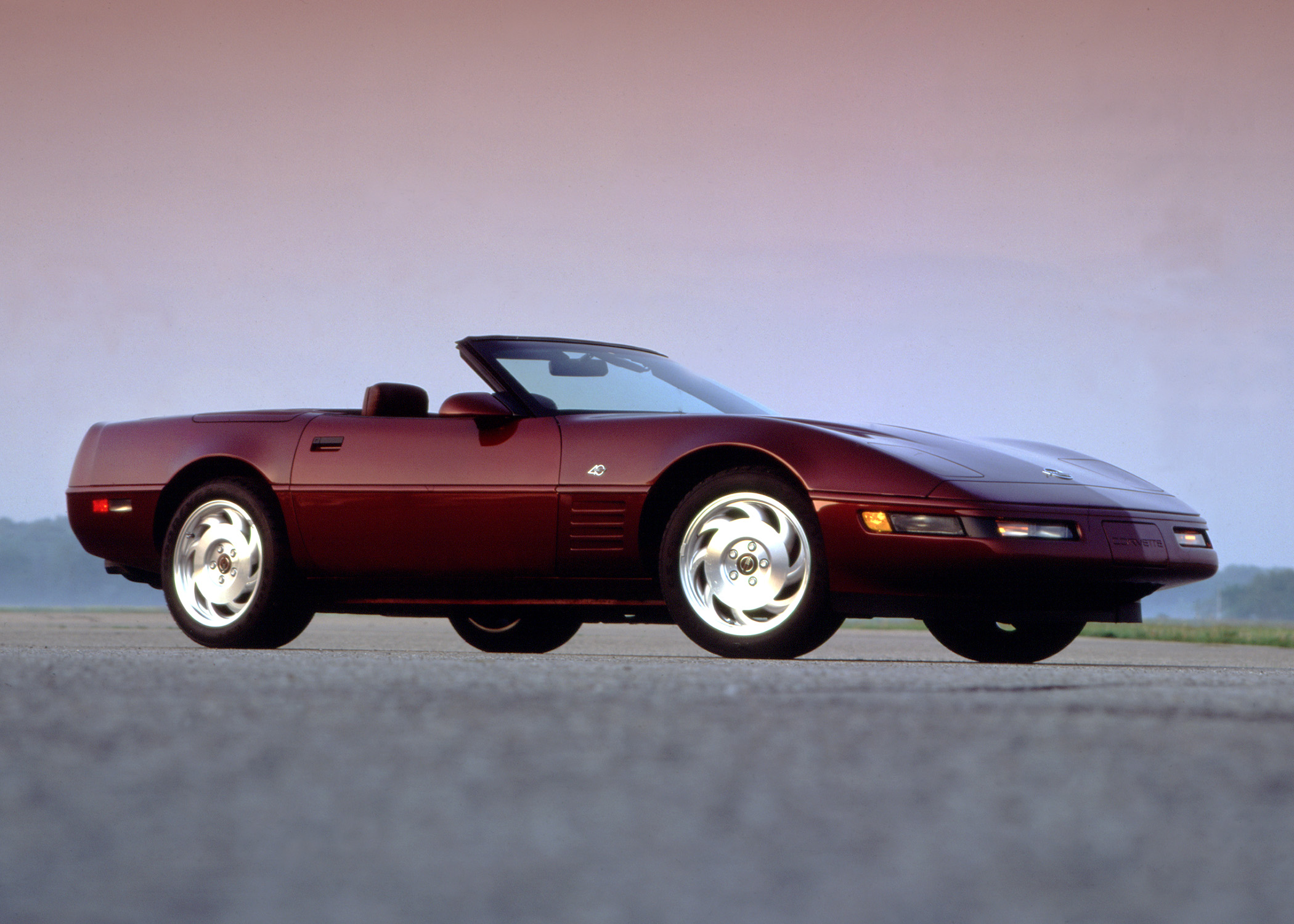 A maroon C4 Corvette was the American sports car of the '90s, seen here at the front 3/4 angle