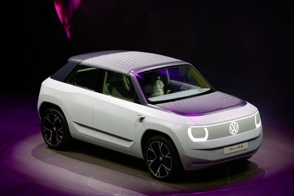 The ultra-minimalist white and grey Volkswagen ID.Life concept, shot from a high front 3/4 angle at the Munich Auto Show