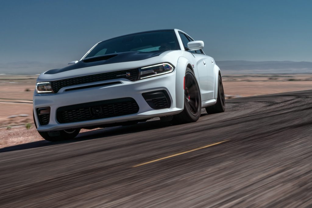 A white Dodge Charger Scat Pack on track at Willow Springs Raceway