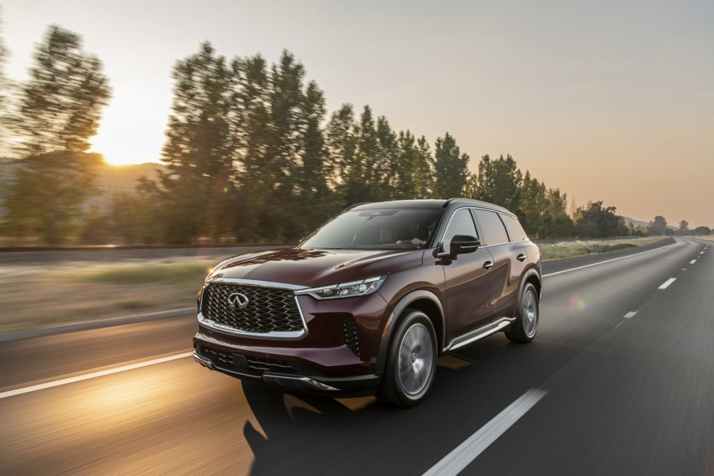 The 2022 INFINITI QX60 driving on the road at dusk